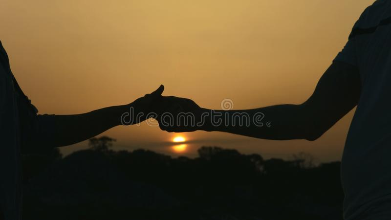 Closeup of man and woman holding hands gently, couple enjoying romantic date royalty free stock photography