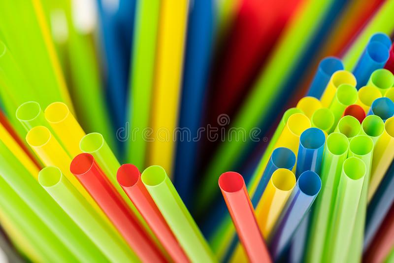 Closeup of many different disordered colored straws stock photo