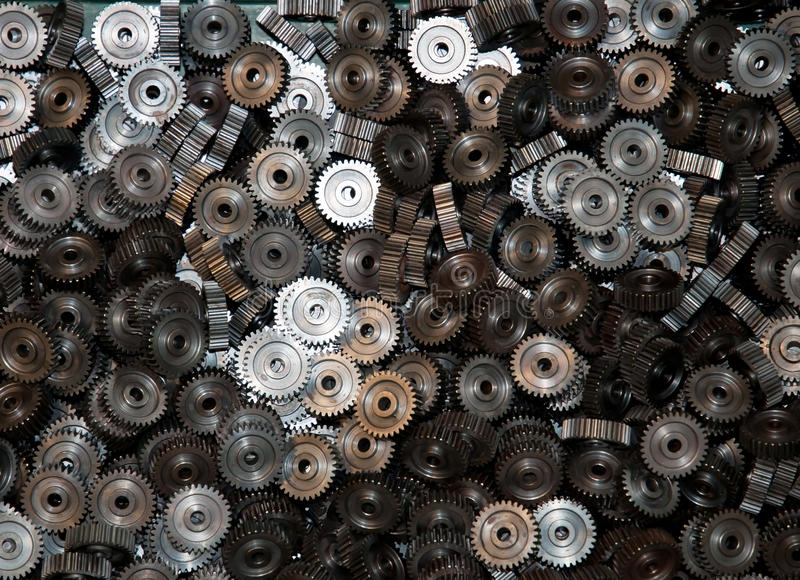 Closeup of many metal gears stock images