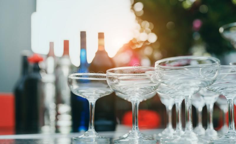 Closeup many wine and cocktail glass for party outdoor relax celebrate. Alcohol luxury drink beverage concept stock image