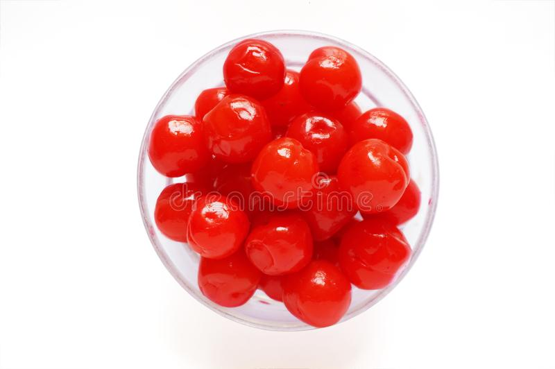 Closeup of maraschino cherries on a glass bowl stock images