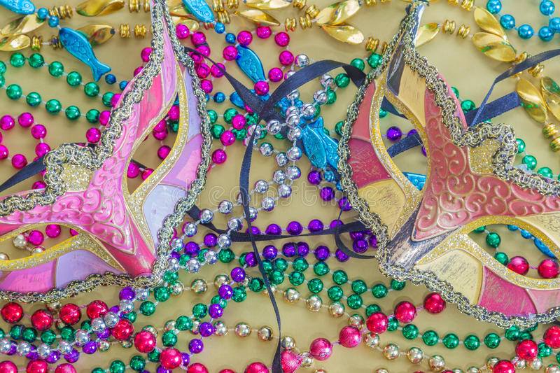 Closeup of Mardi Gras Masks and Beads. Closeup of two Marid Gras Masks and colorful beads royalty free stock image