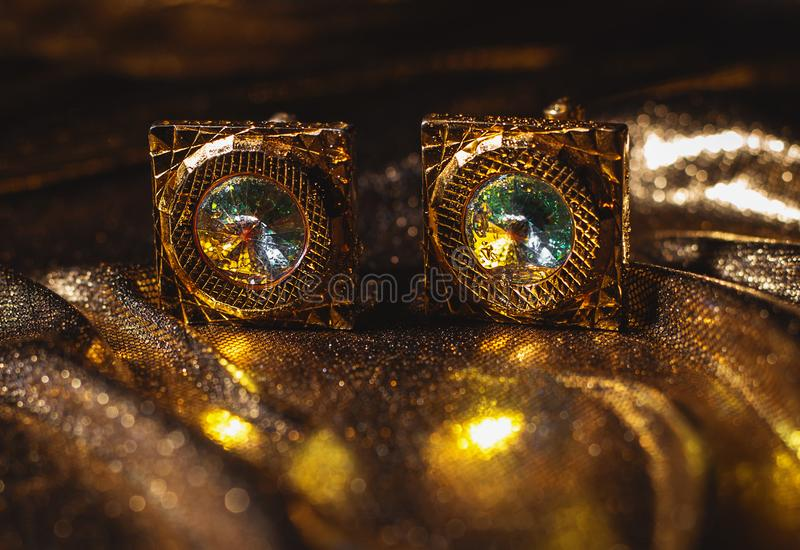 Masculine accessory - golden cufflinks royalty free stock photos