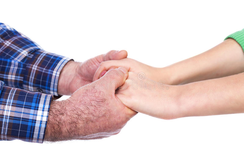 Closeup of mature man hands holding his daughter hands, care con royalty free stock photos