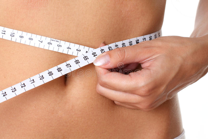 Closeup measurement of a female waist stock photo