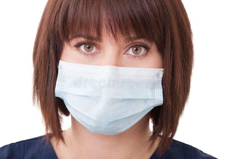 Closeup med framsidan av en härlig tandläkarekvinna arkivfoto