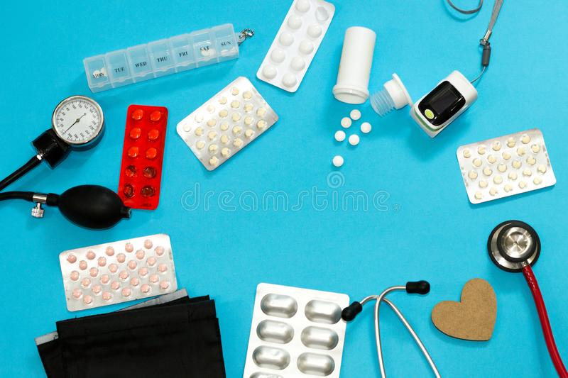 Closeup medical eqipment for measuring life indicators. Diagnosis and treatment concept. Composition of pills, stethoscope, heart royalty free stock images