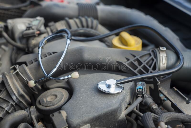 Closeup of medical stethoscope on car engine. Concept for auto service and repair stock photo