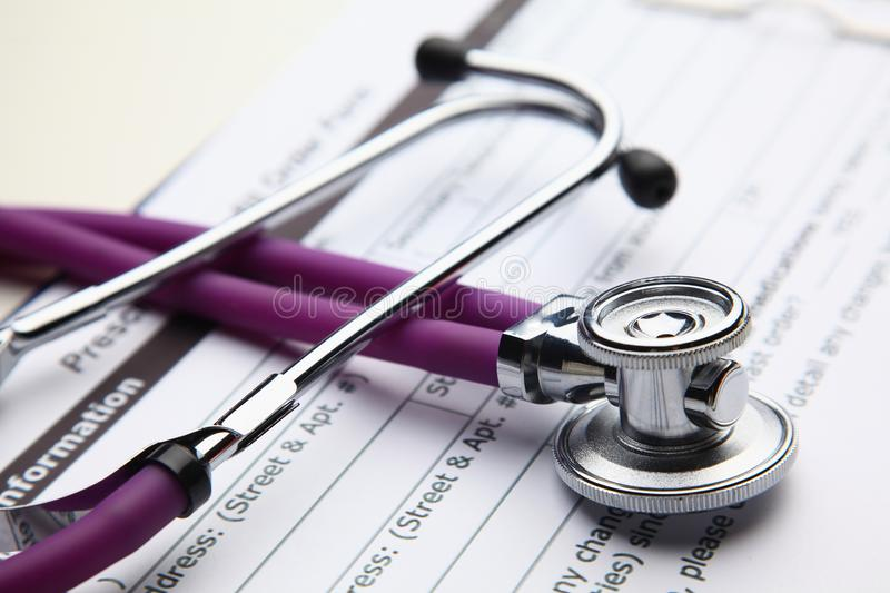Closeup of a medical stethoscope with folder stock photography