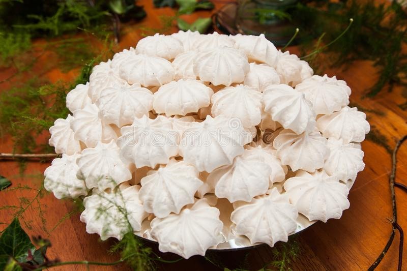Closeup of meringue cookies. Arranged for the guests at the reception stock image
