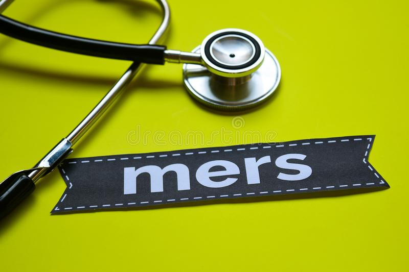 Closeup Mers in french with stethoscope concept inspiration on yellow background stock image
