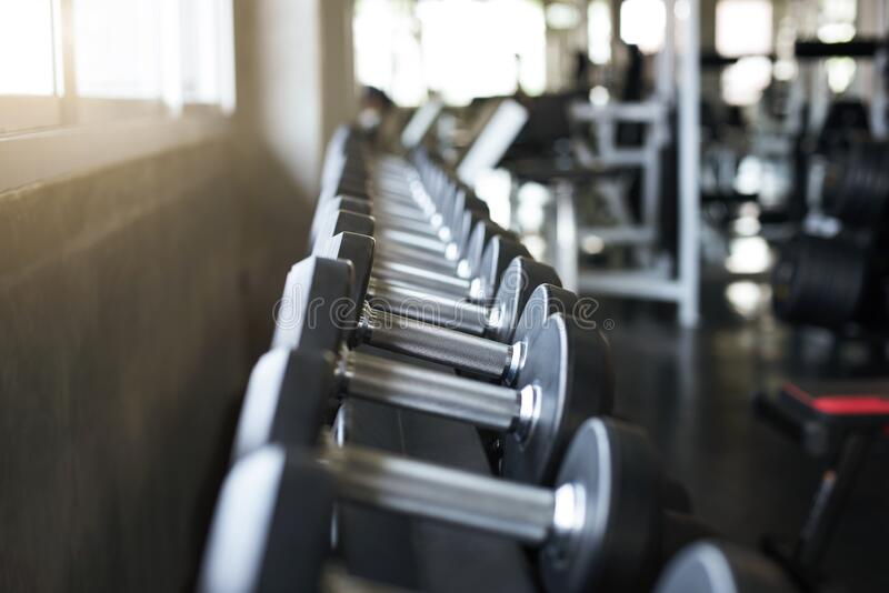 Closeup metal dumbbells in sport fitness gym center royalty free stock photos