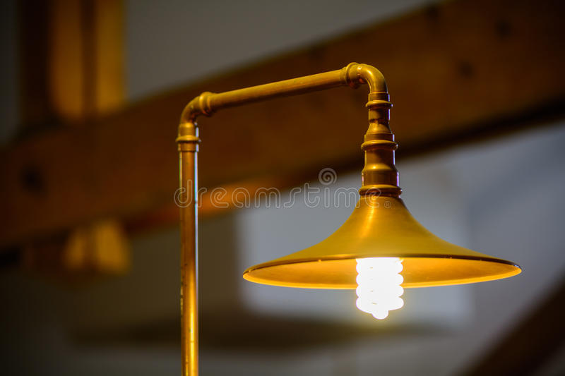 Closeup with metallic lamp. One golden metallic lighted lamp. Closeup with metallic lamp. One golden metallic lighted lamp royalty free stock photos