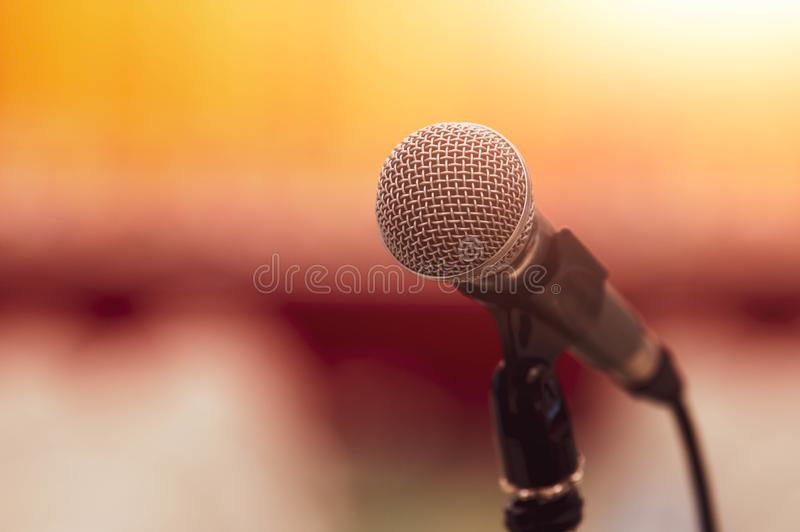 Closeup of microphone on abstract blurred background speech in seminar convention hall room and light as guest and conference stock image