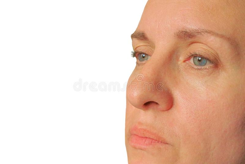 Closeup of middle aged woman face. Real skin without make up and correction. Don't look at camera. Dont smile. Isolated stock photography