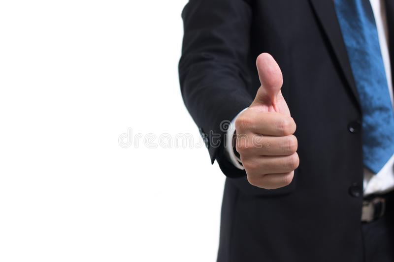 Closeup midsection of businessman wear black suit hand showing thumbs up sign against isolated on white background. royalty free stock photo