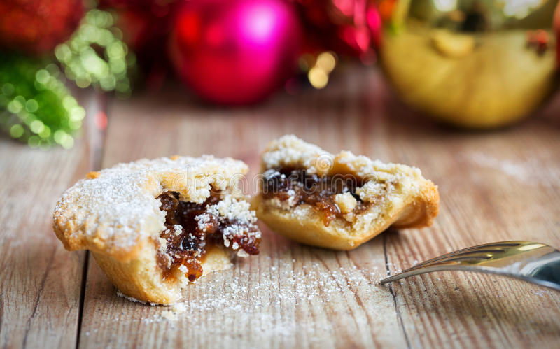 Closeup of a mince pie with a fork. On wooden table stock photo