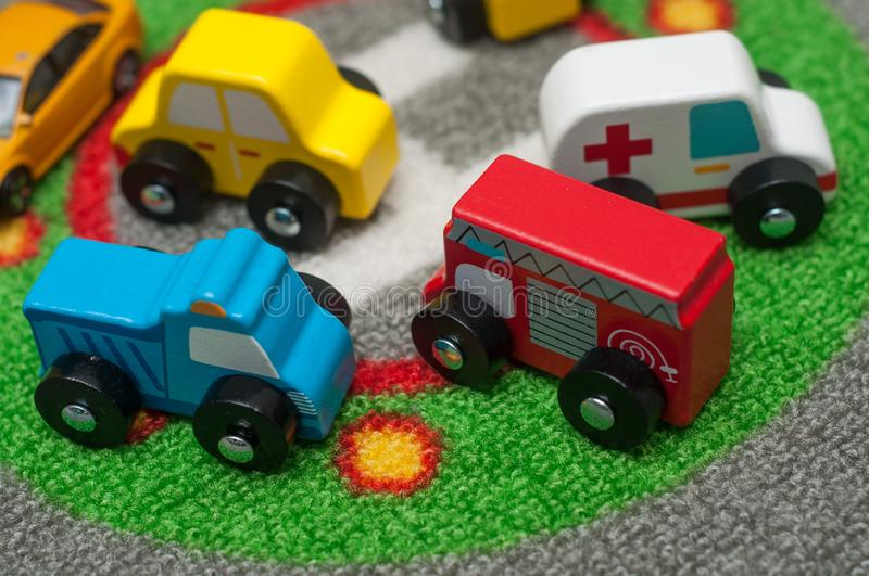 Miniature wooden cars on road carpet on the floor stock photography