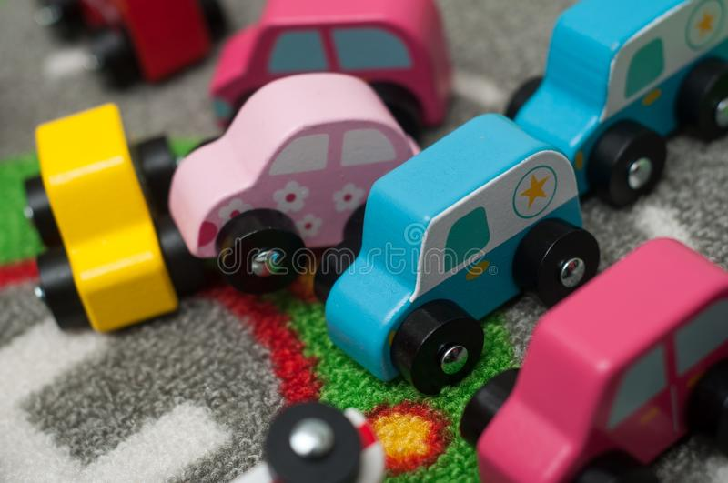 miniature wooden cars on road carpet on the floor stock images