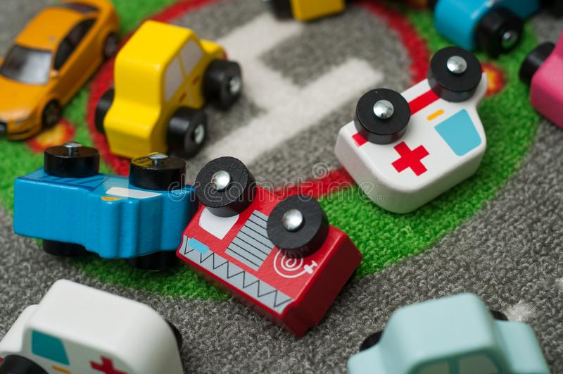 Miniature wooden cars on road carpet on the floor stock photos