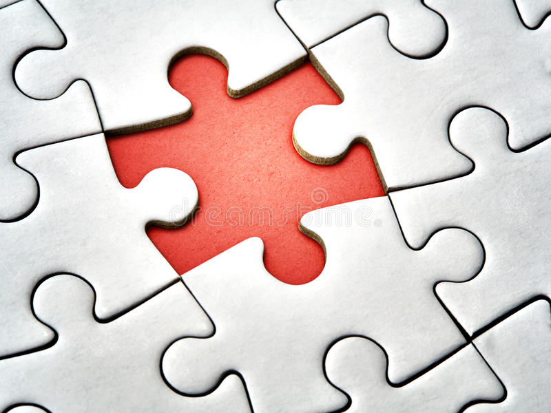 Closeup missing last piece white jigsaw puzzle royalty free stock image