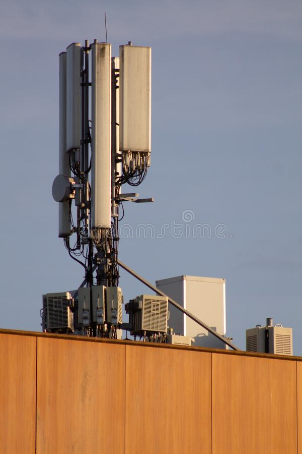 Closeup from mobile telecommunication antenna on a building. Telecommunication antenna for mobile communication. On a building in a city. Radiator warning for stock images