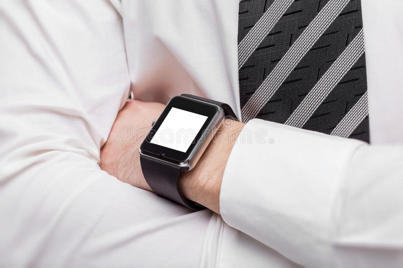 Closeup mockup of crossed male hands with smart watch isolated. At white background royalty free stock photos