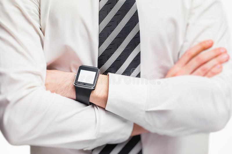 Closeup mockup of crossed male hands with smart watch isolated. At white background stock image