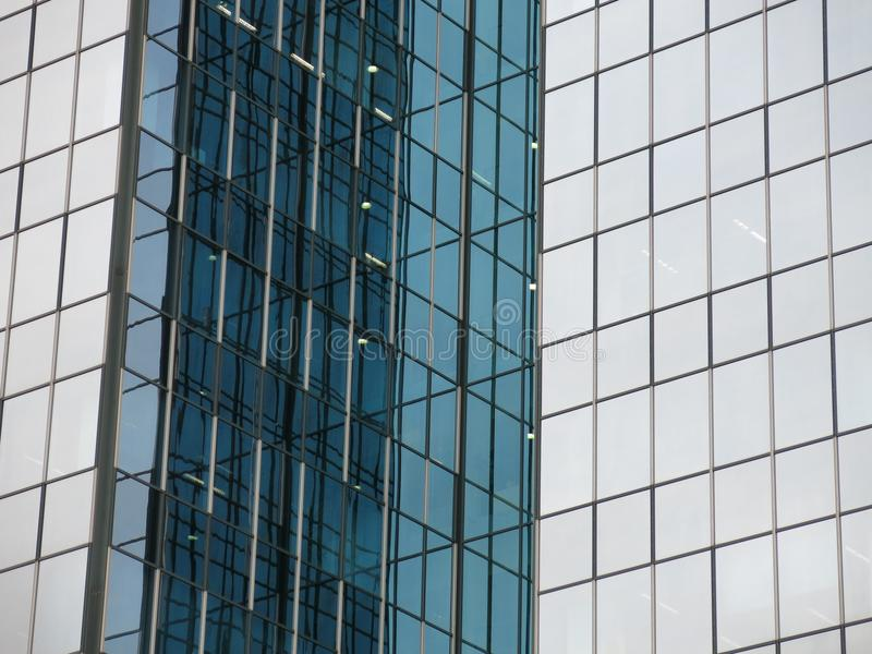 Closeup of modern building. Architectural closeup of modern building creating abstract background of glass, steel and concrete with reflections royalty free stock photo
