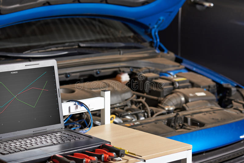 Closeup of modern electronic diagnostic table. Vehicle maintenance of electronic system royalty free stock image