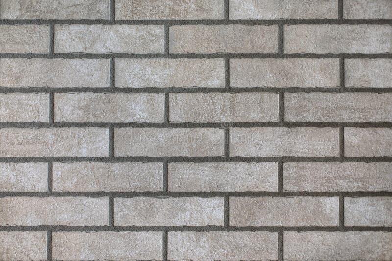 Closeup of modern neutral grey brick wall royalty free stock photos