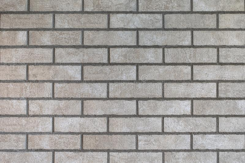 Closeup of modern neutral grey brick wall stock images