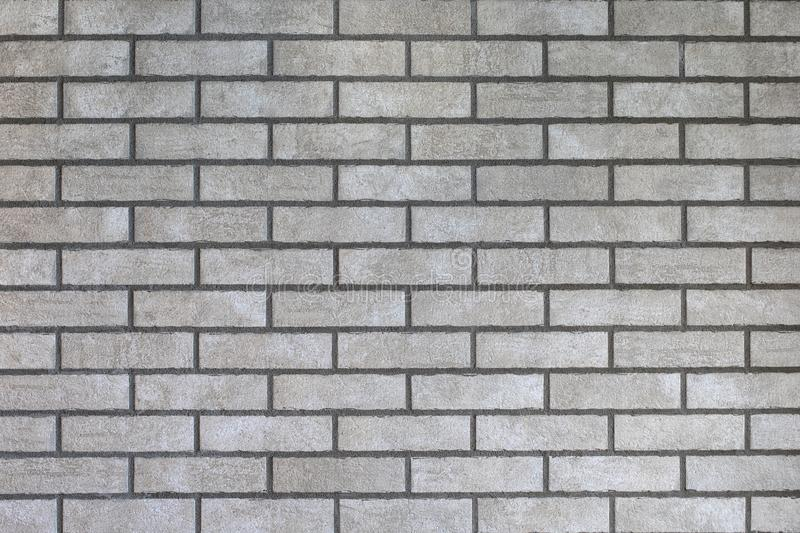 Closeup of modern neutral grey brick wall stock image