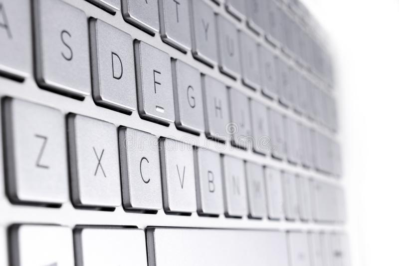 Closeup of a modern silver laptop computer keyboard. Laptop keyboard. Detail of the new and ergonomic computer keyboard stock photo