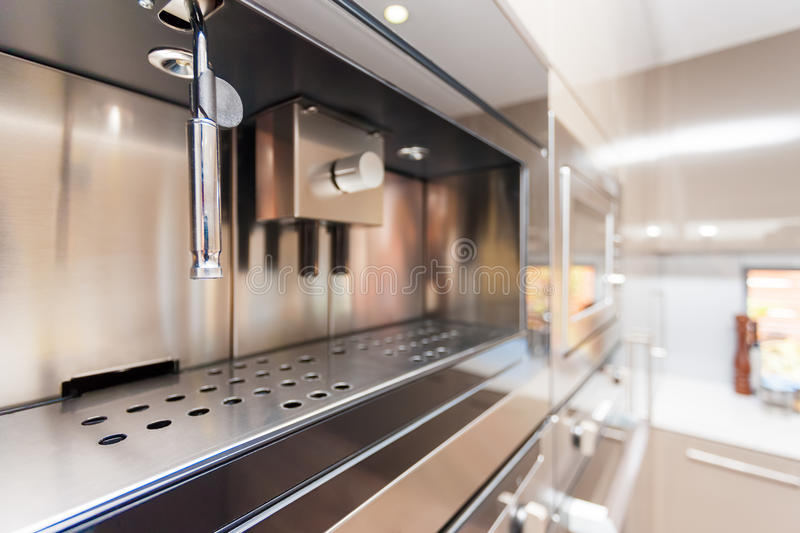 Closeup of a modern wall oven in the kitchen royalty free stock images