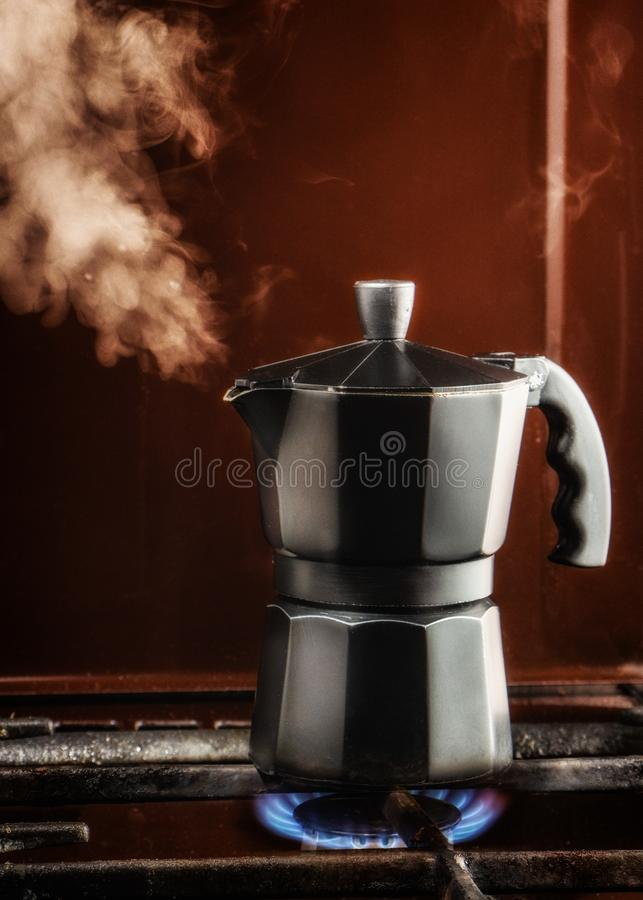 Closeup of Moka coffee pot on a gas stove Boils and lets off steam. Close up, kitchen, white, design, espresso, metal, background, beverage, breakfast, caffeine stock photos
