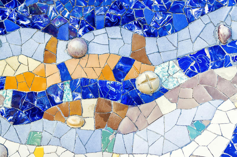Closeup of mosaic of colored ceramic tile by Antoni Gaudi at his royalty free stock photo