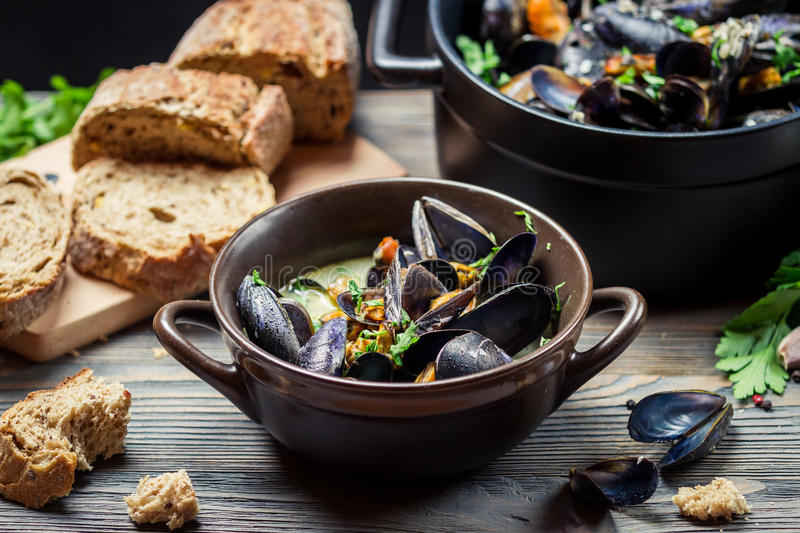 Closeup of mussels and fresh vegetables served at home stock images