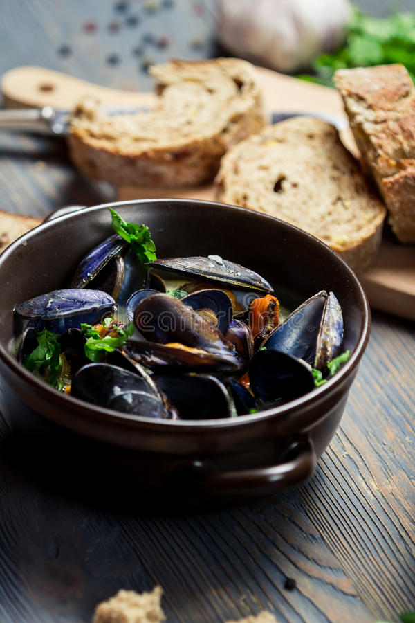 Closeup of Mussels served with bread stock images