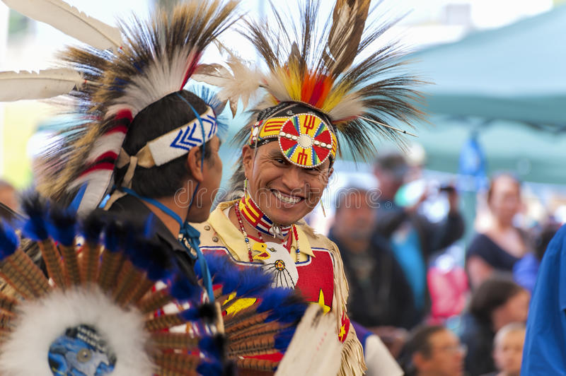 Closeup of Native Americans dressed in full Regalia. Portland, Oregon, USA - June, 14, 2014: Native Americans dressed in full regalia laughing and having fun at royalty free stock photography