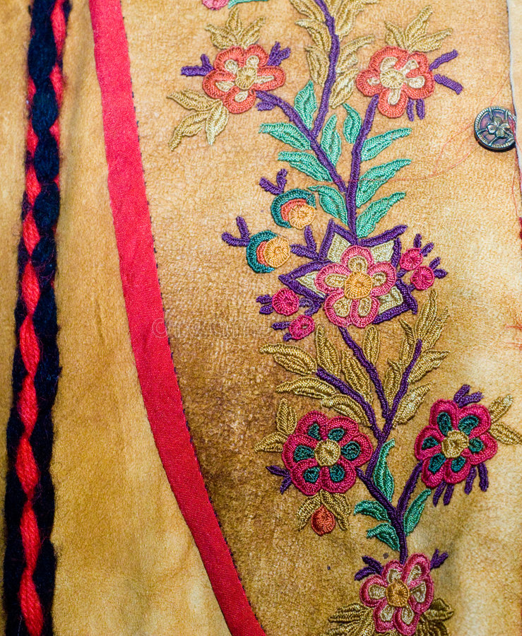 Closeup Native Clothing. Closeup view of a floral pattern stitched into native american clothing stock images