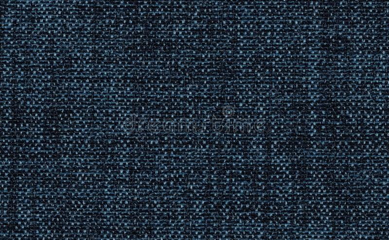 Closeup navy blue color fabric texture. Strip line dark blue,indigo blue fabric pattern design or upholstery abstract background. Closeup navy blue color fabric royalty free stock image