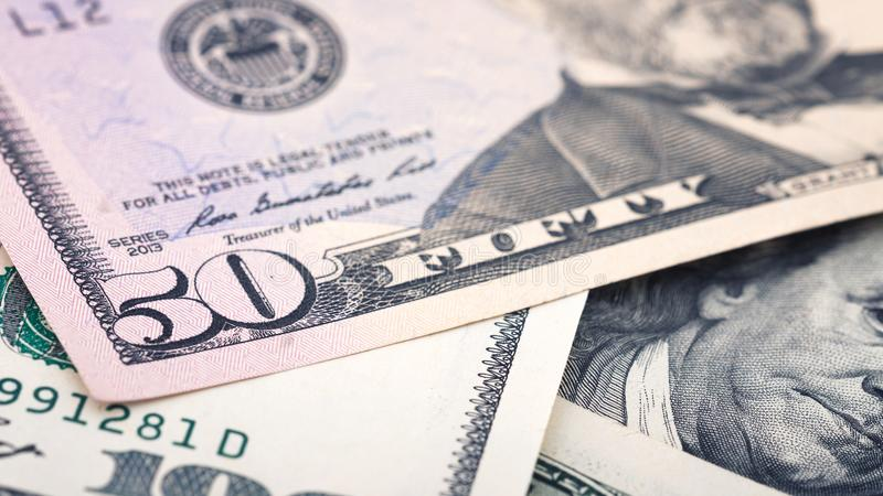 Closeup new American money fifty dollar bill. US 50 dollar banknote fragment macro royalty free stock photos