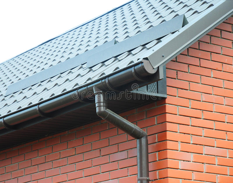 Closeup On New Rain Gutter System And Roof Protection From
