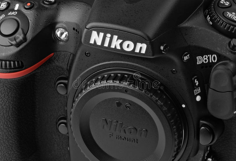 Closeup Nikon D810. Close-up Nikon D810 camera body, the first digital SLR camera in Nikon's history to offer a minimum standard sensitivity of ISO 64 royalty free stock images