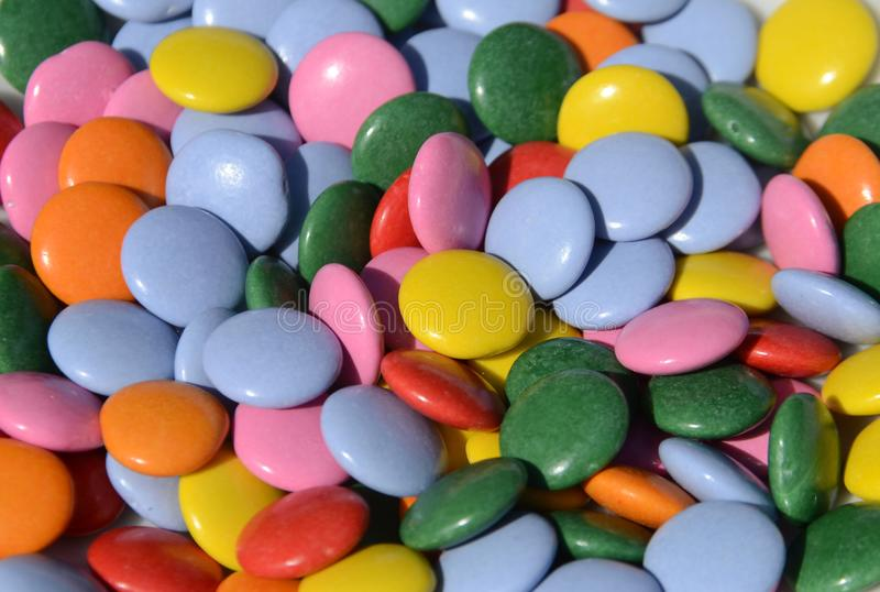 Closeup on numerous chocolate lenses with colorful covers.  royalty free stock photography