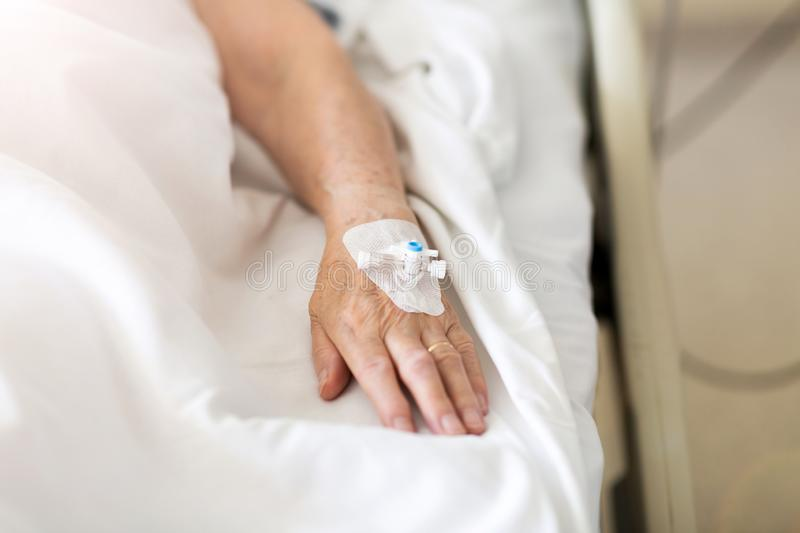 Cropped Image Of Patient With Iv Drip At Hospital royalty free stock image