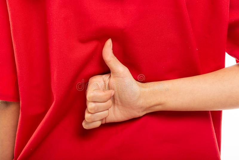 Closeup of nurse wearing red scrubs showing like. Or thumb up isolated on white background royalty free stock photos