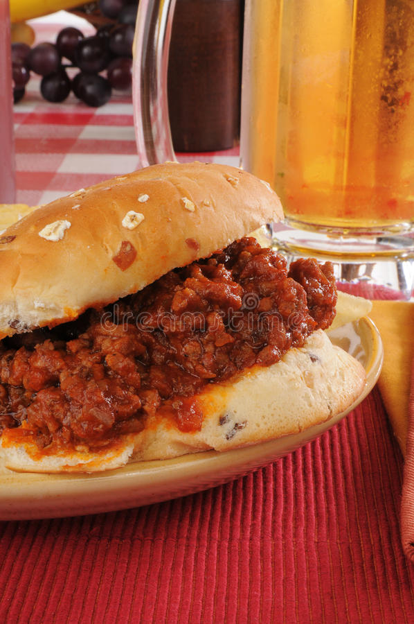 Download Closeup O A Sloppy Joe And Mug Of Beer Stock Photo - Image of condiments, ground: 26708226