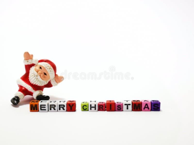 Closeup och makroskott av jultomten med kvarterleksaken för glad jul royaltyfria bilder